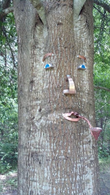 Tree man says Welcome!