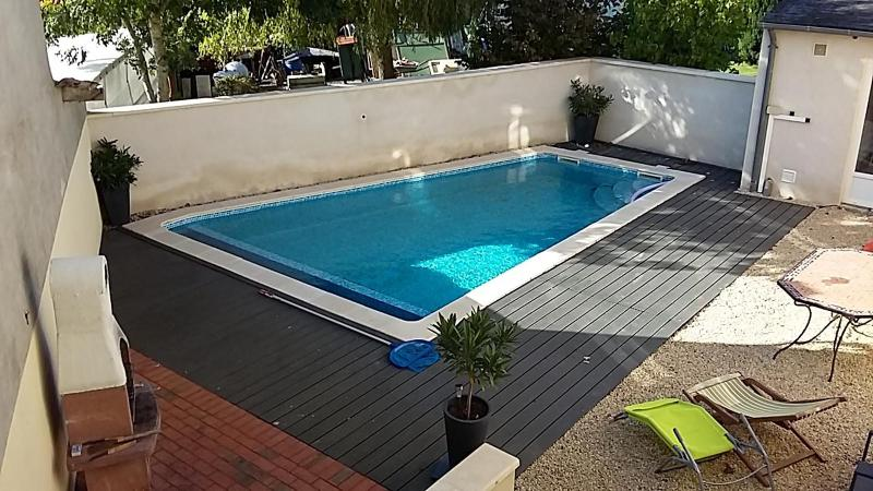 Private sunny courtyard with heated saltwater pool