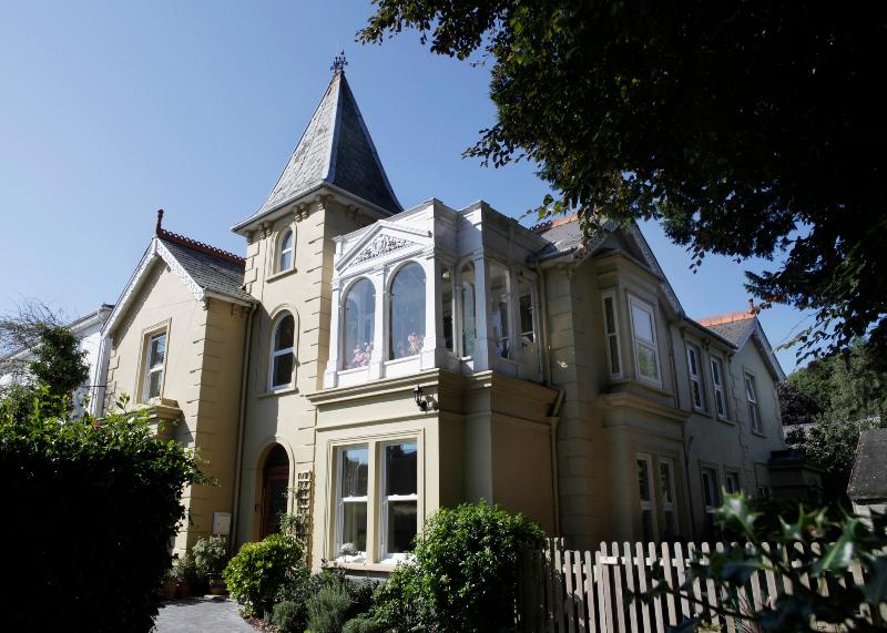 Tower House is a beautiful old Victorian property with a tower and a charming belvedere