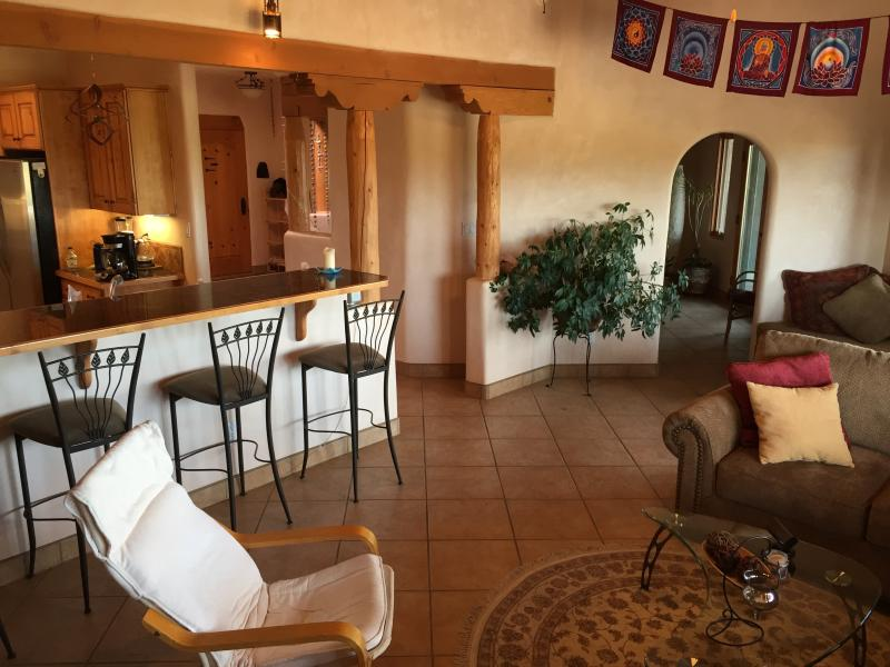 View from media room with breakfast bar on left and living room ahead