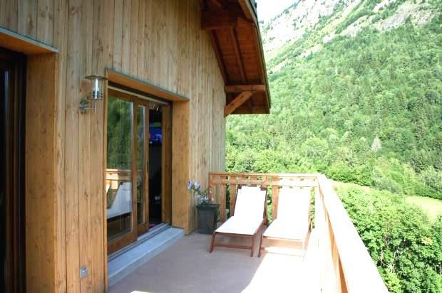 The lovely sunny balcony overlooking uninterrupted views of the mountains