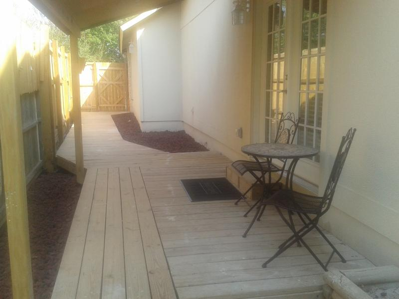 New covered patio decks in front and outside master bedroom