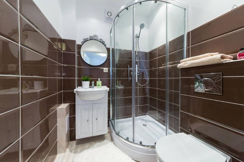 Bathroom, shower, toilet, sink, towels, hairdryer, bathroom necessities
