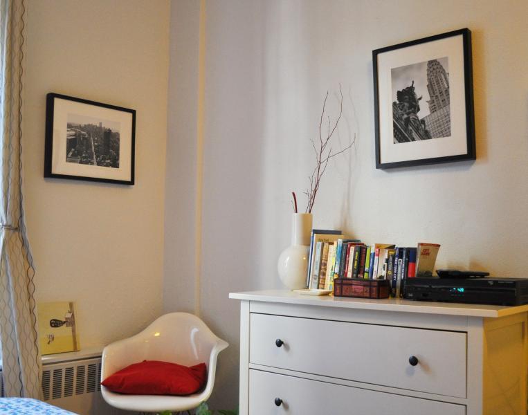 Original, signed artwork fills the apartment.