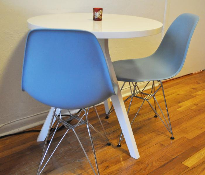Authentic Eames chairs for the dining table, which also serves as a work station.