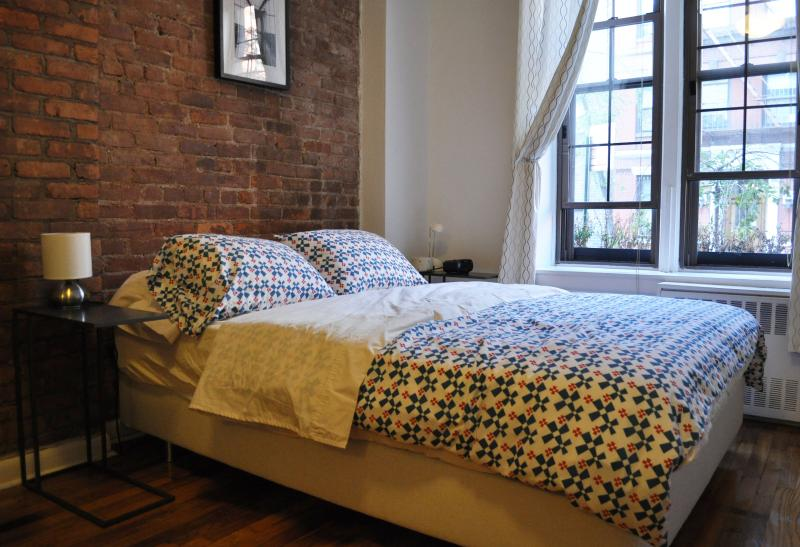 The queen bed has a foam topper, feather pillows, and Egyptian cotton sheets.