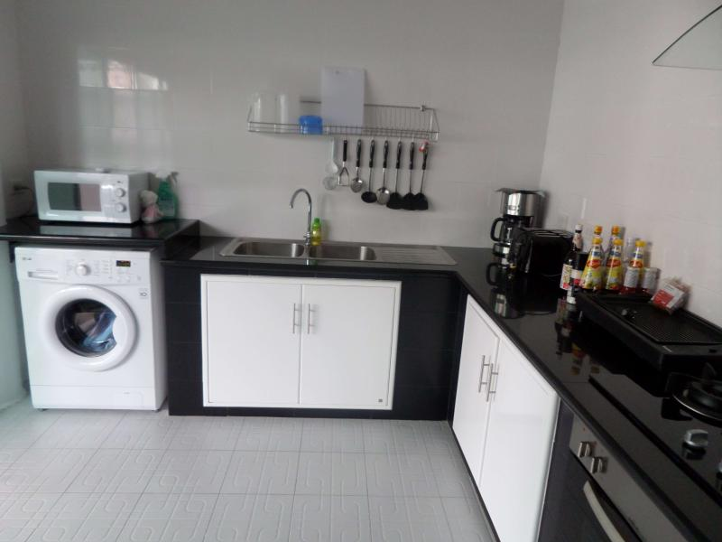 fully equipped kitchen with large refridgirator