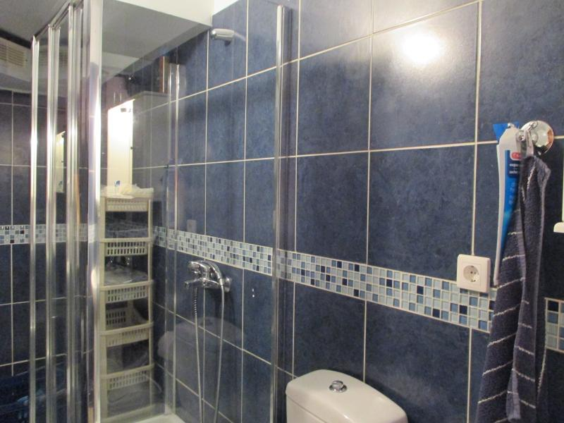 Compact bathroom with toilet, shower, basin and washing machine