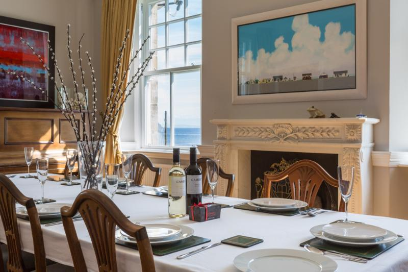 The formal dining room with beautiful artwork