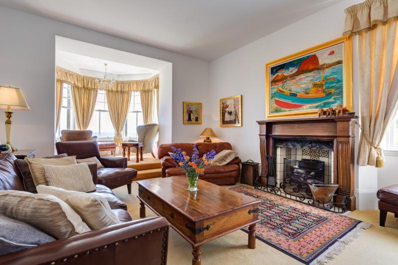The drawing room with open fire and sea views
