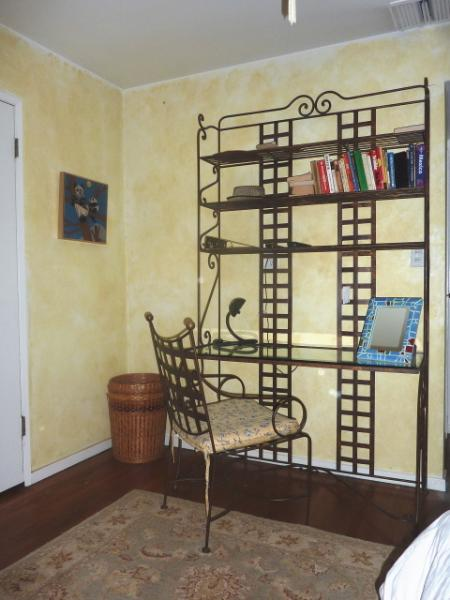 Etagere above the glass topped desk