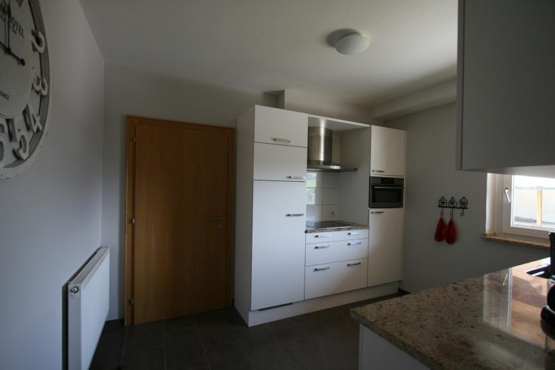 Kitchen 'smaller' appartement with dishwasher, ceramic heat, refrige, freezer, oven , pots, pans etc