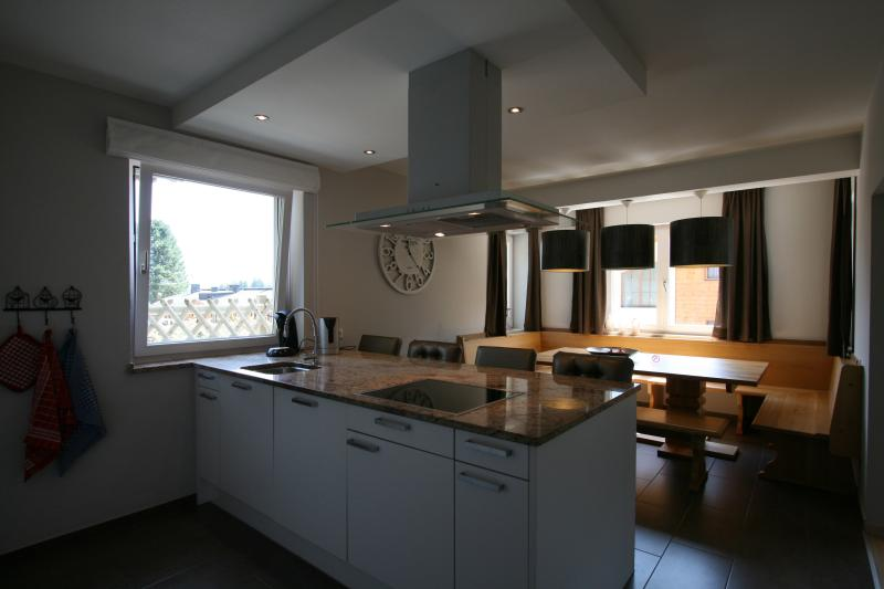 Large kitchen with cooking island.