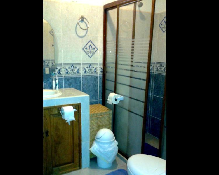 bathroom.  Updated enclosed shower. water under pressure.