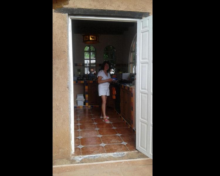 guest in kitchen, viewed from side door to terrace