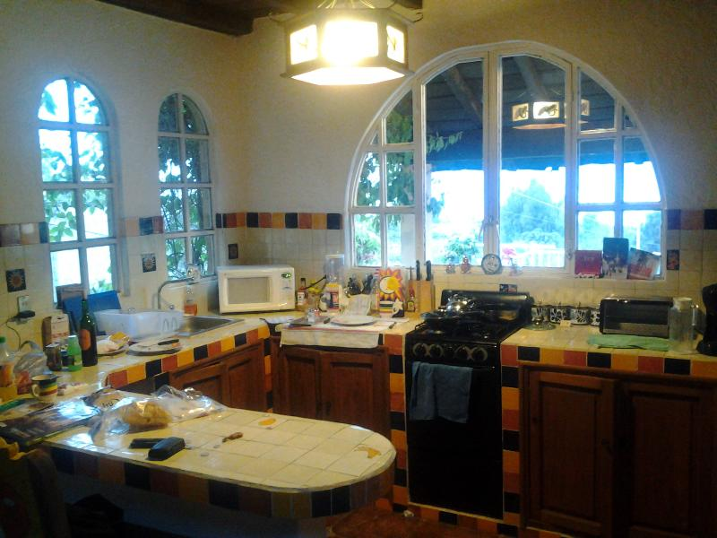 Kitchen and breakfast bar, viewed from dining area
