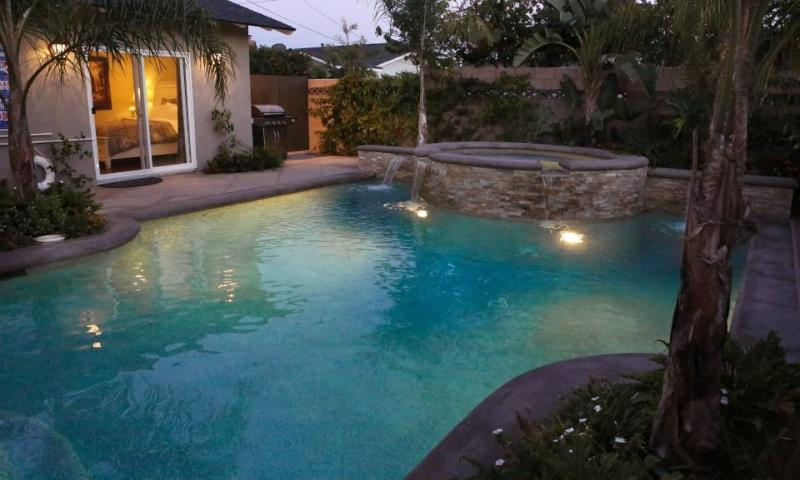 New Pebble-Tec Pool and Jacuzzi at night View 2
