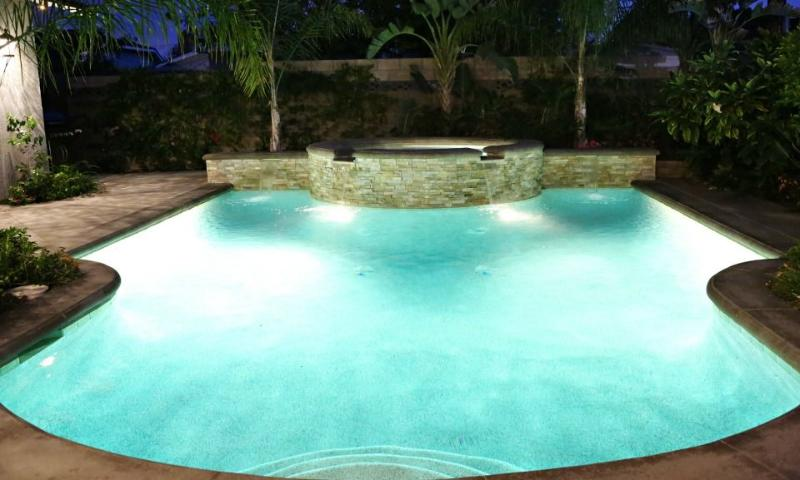 New Pebble-Tec Pool and Jacuzzi at night