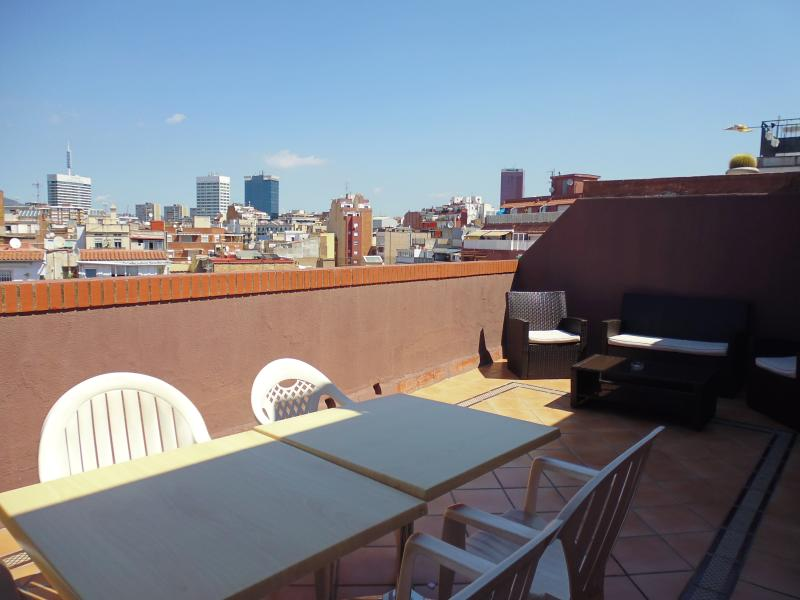 Terrace and views over the city of Barcelona