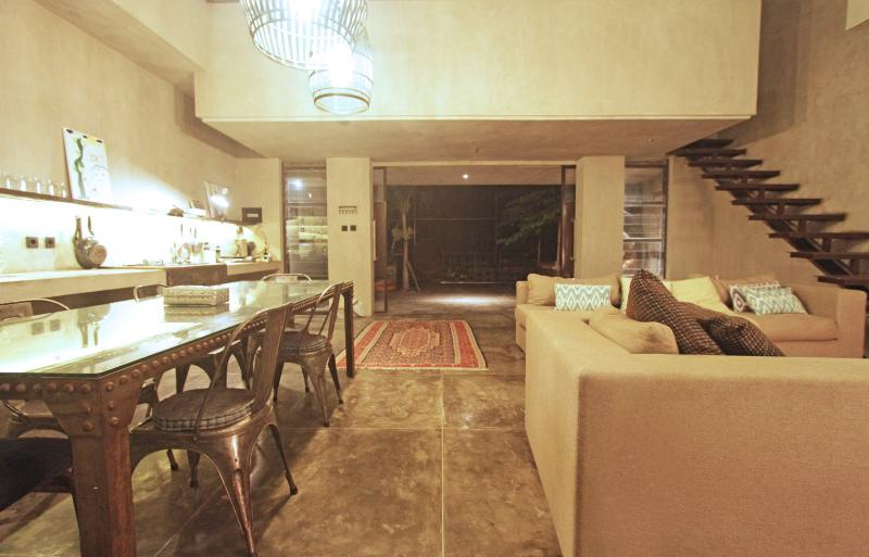 Kitchen area, dinning table, sliding doors to the terrace, living and stair access to 3rd bedroom