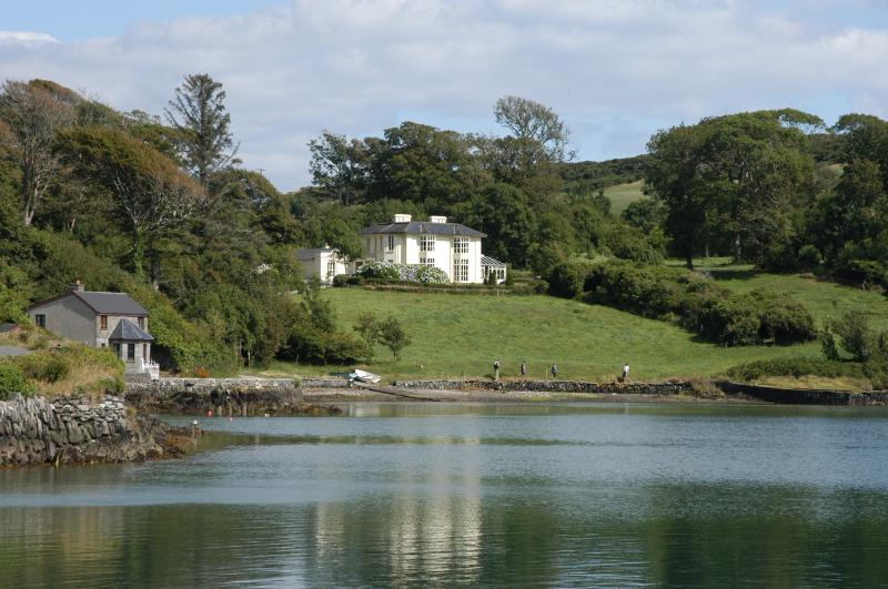 Lough Ine House and the Gate Lodge from the lake