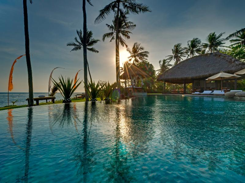 Taman Ahimsa - View across pool at sunset