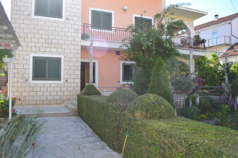 Apartment's front with the garden