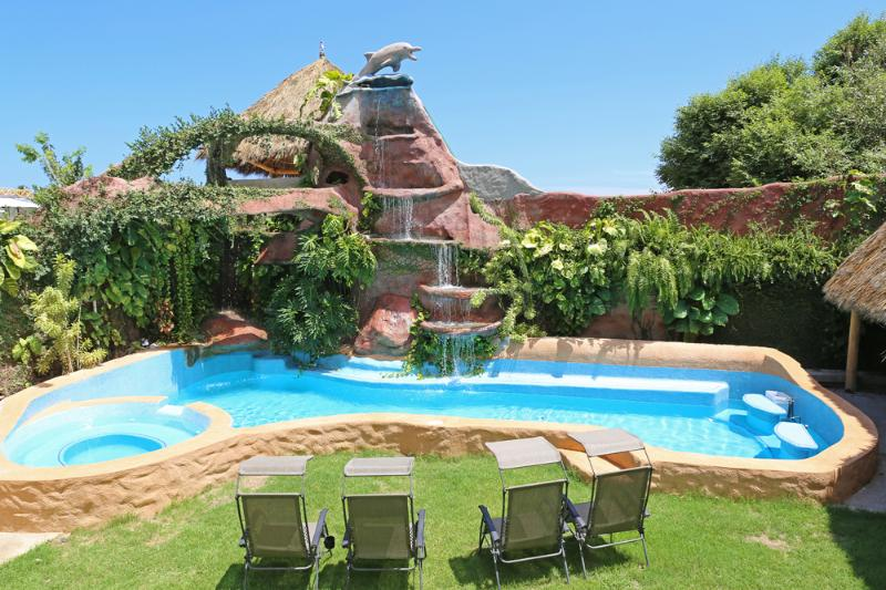 25' high waterfall cascades down to a large swimming pool.  Poolside seating with sun or shade.