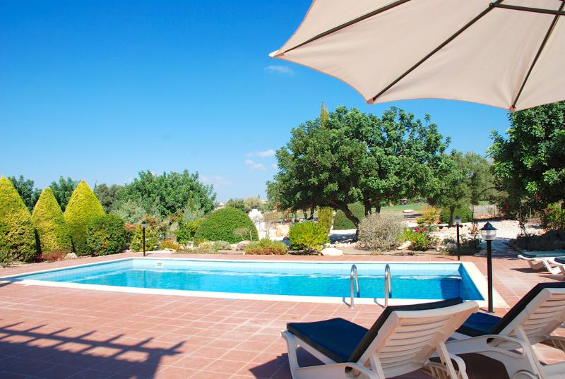 Kick back and relax by the pool and enjoy the peaceful surroundings