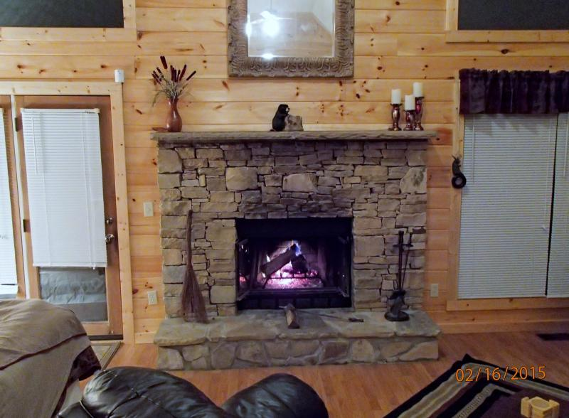 With the open floor plan you can enjoy the beauty of the fireplace throughout the cabin