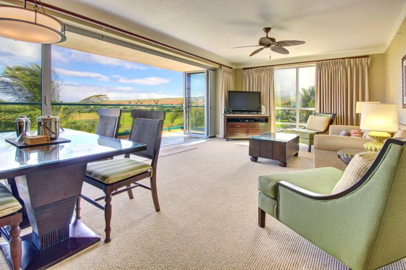 Living room with open access to lanai and unobstructed view to West Maui Mountains and rainbows!