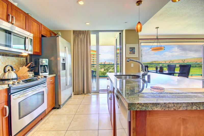 Kitchen with view into lanai and interior dining -- dining for six also available on 505sqft lanai!