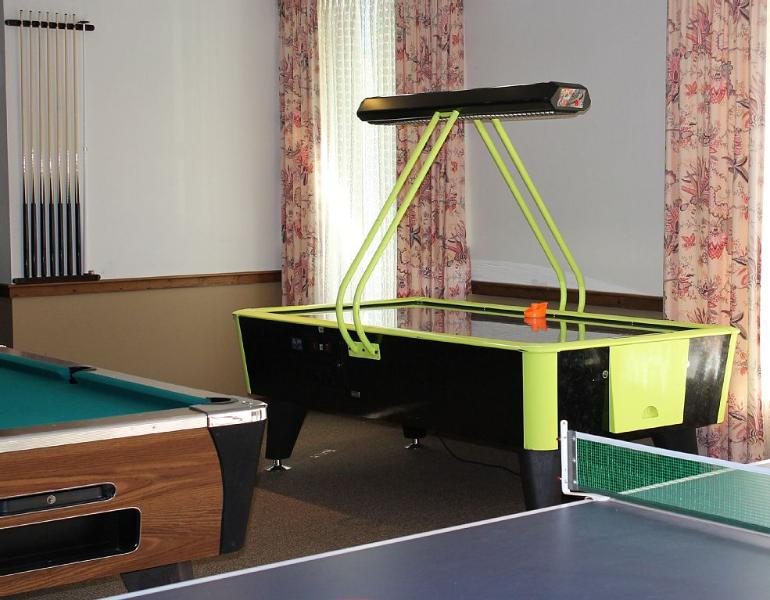 Game Room with Air Hockey, Pool, Ping Ping, Foosball, and Several Coin Operated Video Games.