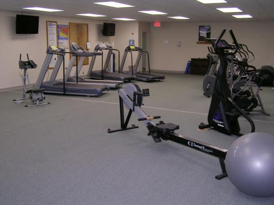 Fitness Center with Weights and Cardio Equipment.