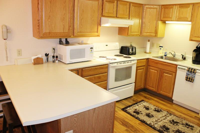 Full Kitchen with 4 Burner Stove/Oven, Microwave, Toaster, and Keurig. Seating for 2 at Bar.