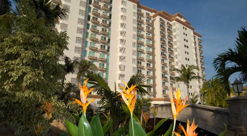 Paraiso Costa Bonita II exterior building with its Beautiful Tropical Garden