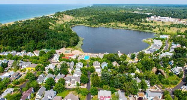 Aerial photo of Beachwalk with Lake Kai, Lake Michigan, and beautiful dunes