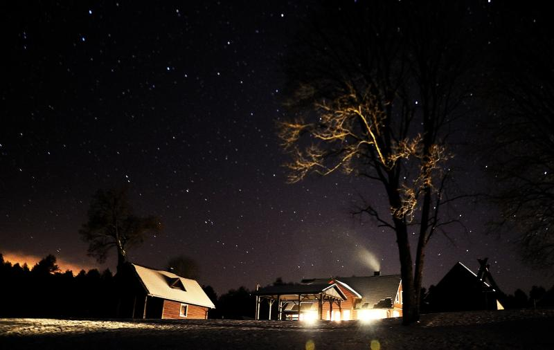 Winter night view of holiday house 'Dzukijos uoga' in Lithuania