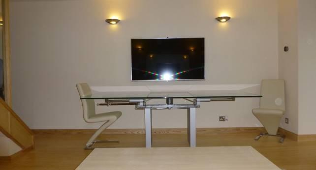 Lounge with 55' smart TV and designer furniture. Rolf Benz style and Ronald Schmitt K5000 table