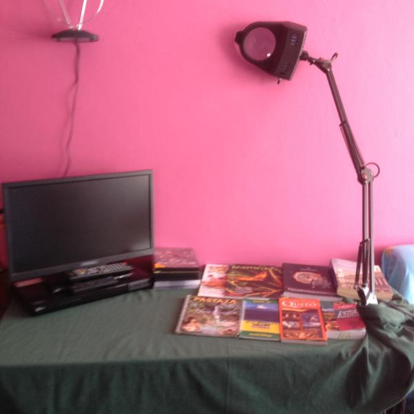 TV, DVD, LAMP, MAPS, BOOKS OF ECUADOR OVER THE DESK