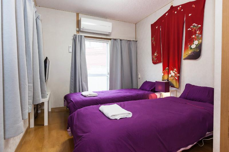 The Master Bedroom (Purple Bed)