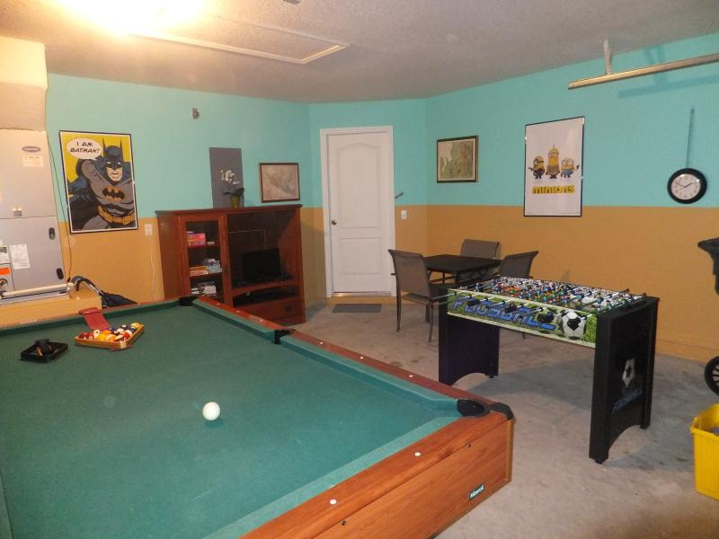 Games room, PS3 with a selection of games, board games, selection of books