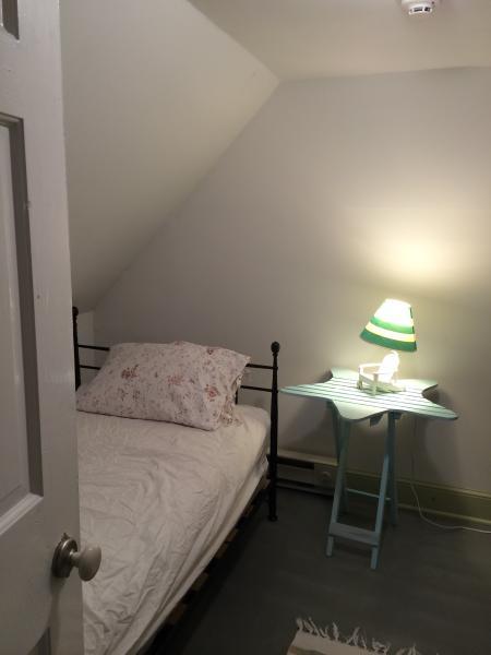 Cozy sleeping loft with fan