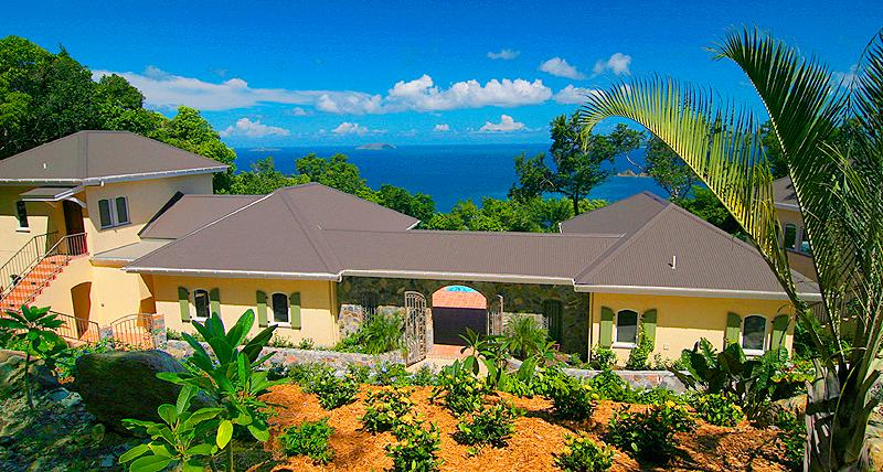 Tropical landscaping surrounds Villa Peace and Plenty Villa.