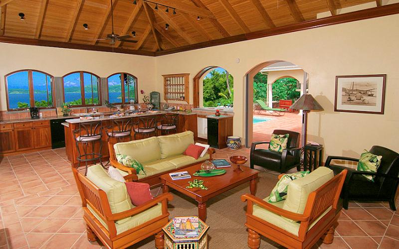 The P&P Great Room looking towards the kitchen w/ a gorgeous Caribbean view, exits to the pool deck
