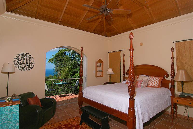 The upper master bedroom of the Garden Wing, with private Caribbean view balcony.