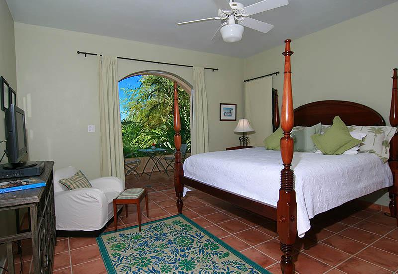 The lower master bedroom of the Garden Wing with private Caribbean view balcony.