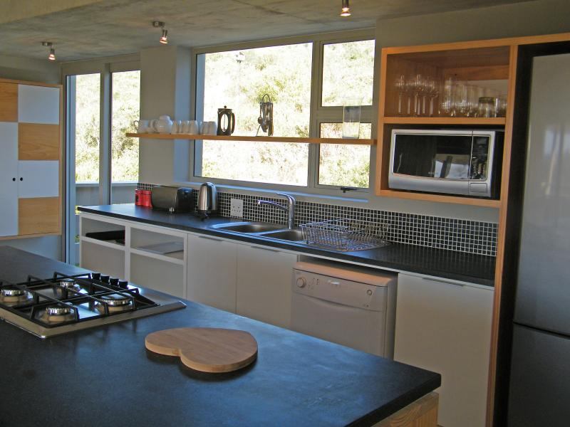 Fully equiped kitchen with private deck at the back