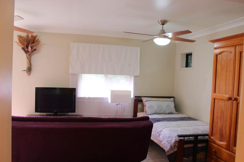 There are 2 large fans for those hot weather days, & wardrobe is a handy space for keeping clothes