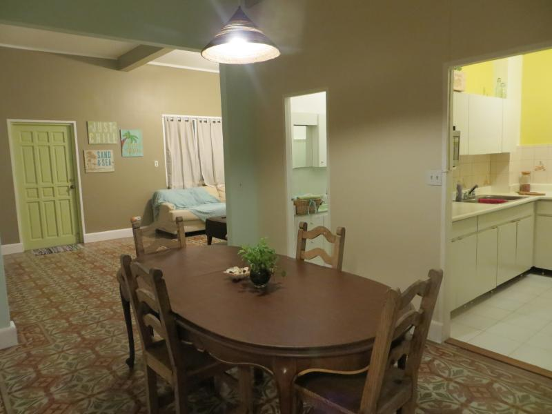 View of Dining, Kitchen and entry way... we love our tiled floors!